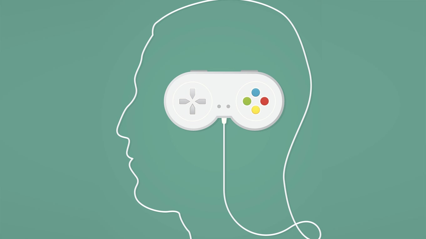 head profile with video game controller for brain