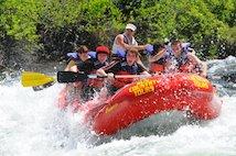 Students having fun rafting