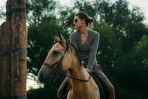 Woman riding horeseback