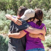 Group of teens embracing in hug