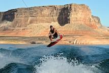 Man wake-surfing on lake