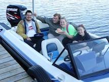 Students on a boat at a dock