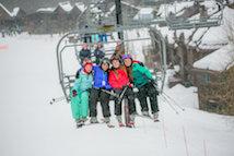 Group of teens on ski lift