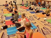 Group of students practicing meditation