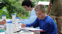 Students studying at table outside