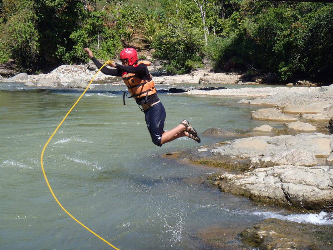 student jumping into costa rican water