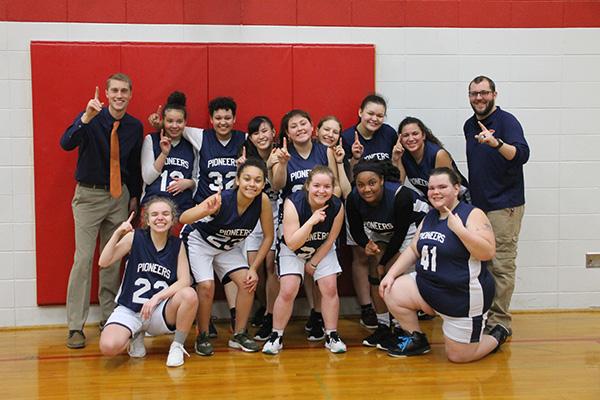 Girls basketball team celebrating their win