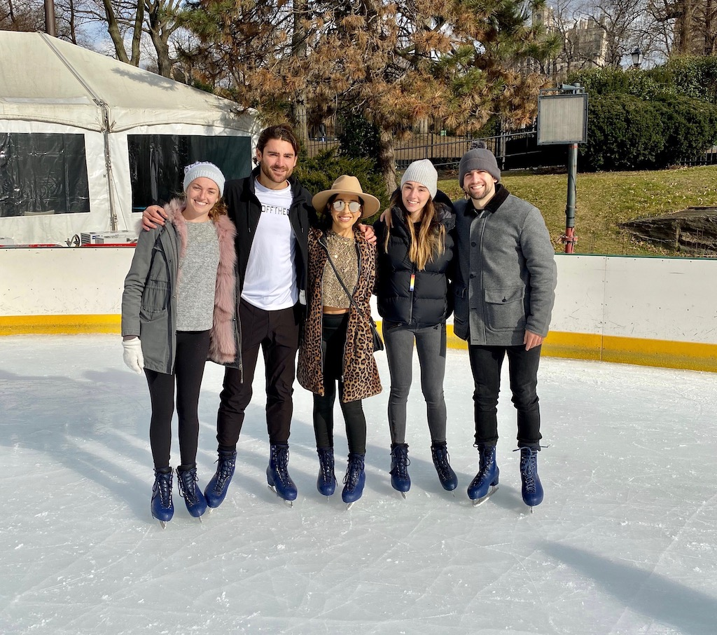Group of adults ice skating