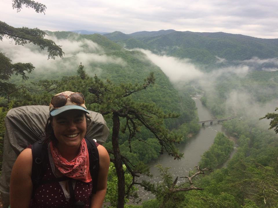 Micaela Cypher hiking with a backpack