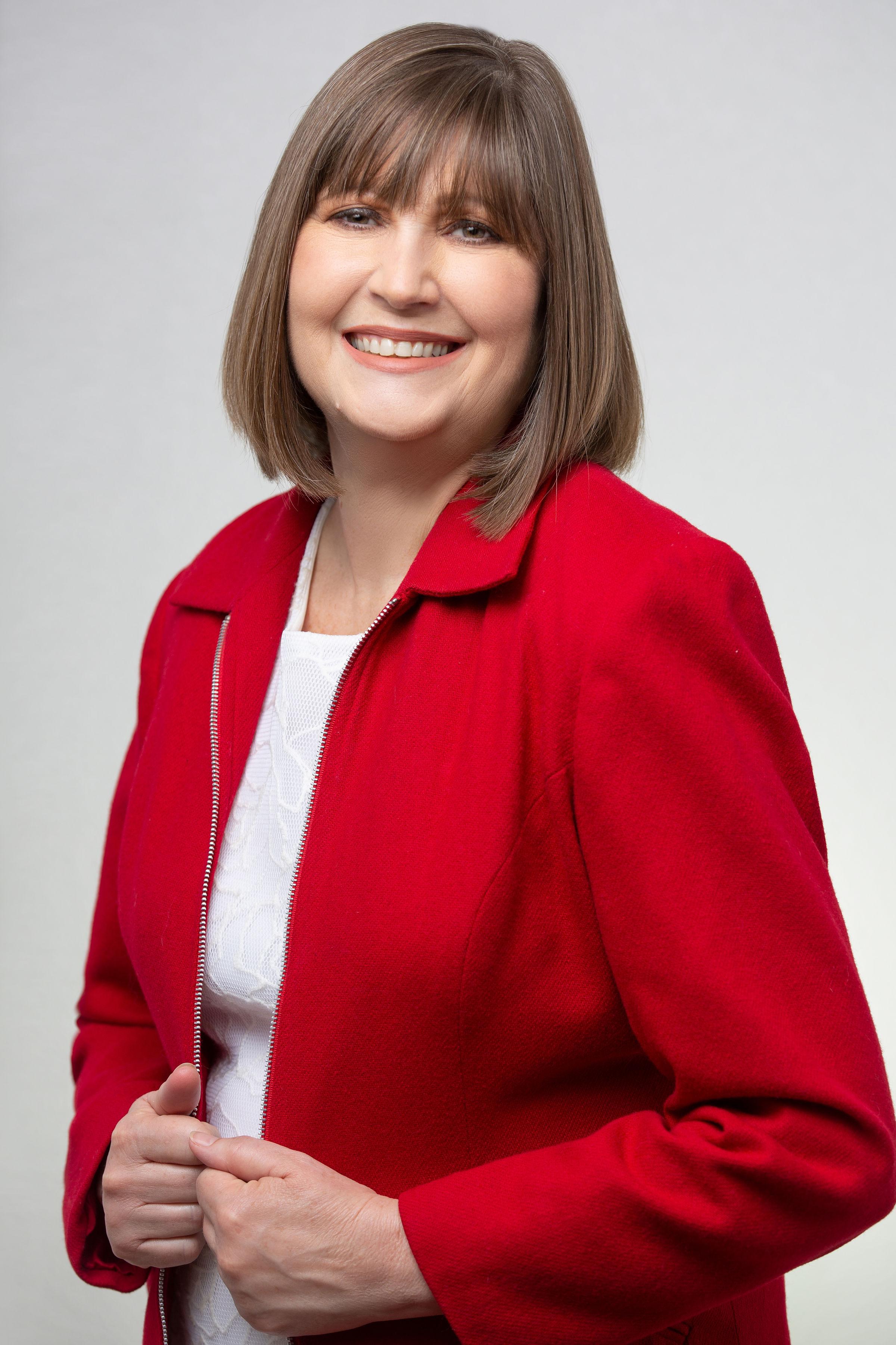 Lisa Nichols wearing red blazer