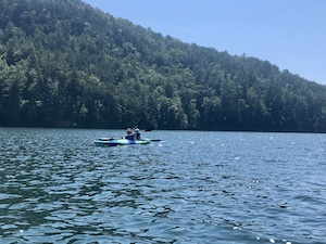 Photograph of Foundations Asheville students kayaking on a lake in NC.