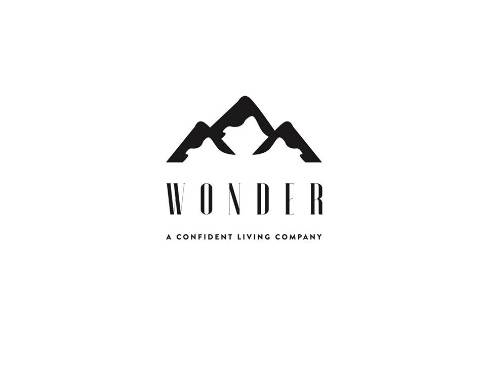 logo for wonder with mountains and the word wonder, a confident living company