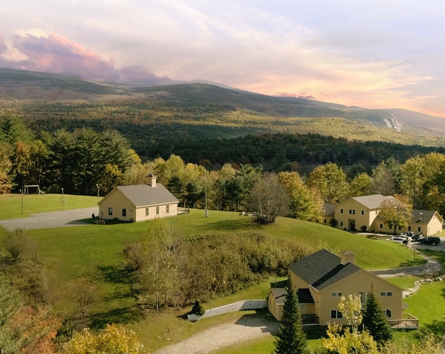 arial photo of Oliverian School Campus with rolling New Hampshire hills