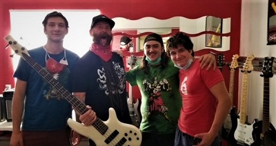 Photo of Chris Kael, bassist for Five Finger Death Punch, and three clients.