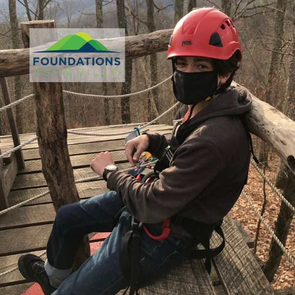 photograph of a Foundation Asheville client with a Foundations logo in upper left.