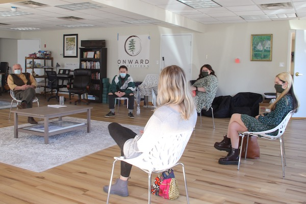 photo of a group meeting at the new Onwards Transitions building.